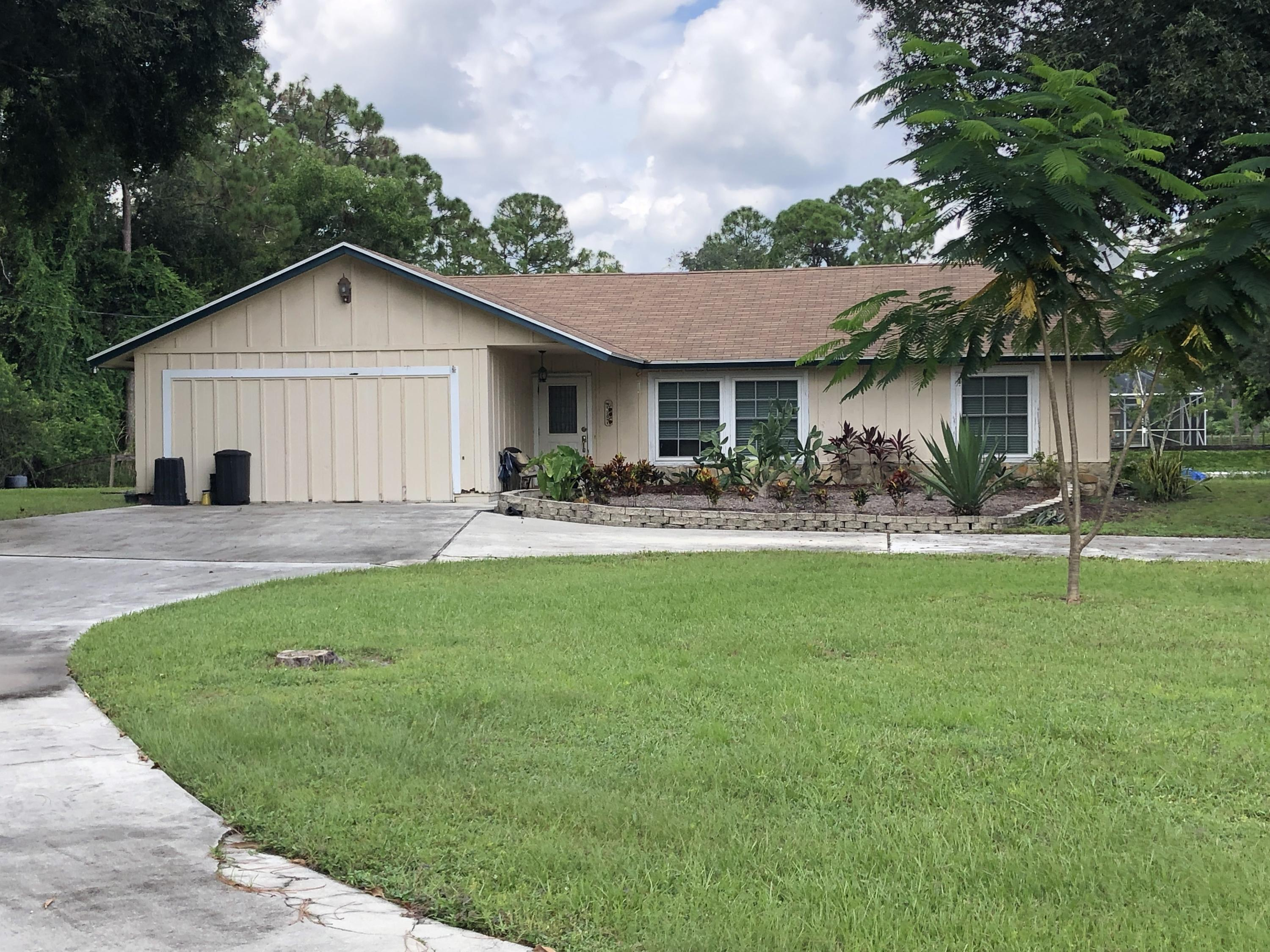 Home for sale in lox The Acreage Florida