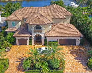 14062 Paradise Point Road is an ultra-private location right in town, 1.5 miles from gorgeous Juno Beach. This is a very unique and very private direct intracoastal home site with an unobstructed eastern view of the Juno Beach Preserve wooded area.   This owner centric transitional style home was completed in November of 2013.   A virtual tour can be viewd at Vimeo by typing the street address on the Vimeo web site. Luxurious master suite accommodations spoil the owners with a panoramic view of the intracoastal waterway and Juno Beach Preserve.  The 10 x 17 her master walk in closet in the master suite only complements the unbelievable onyx laden 15 x 25 master bathroom with backlight onyx counter tops.