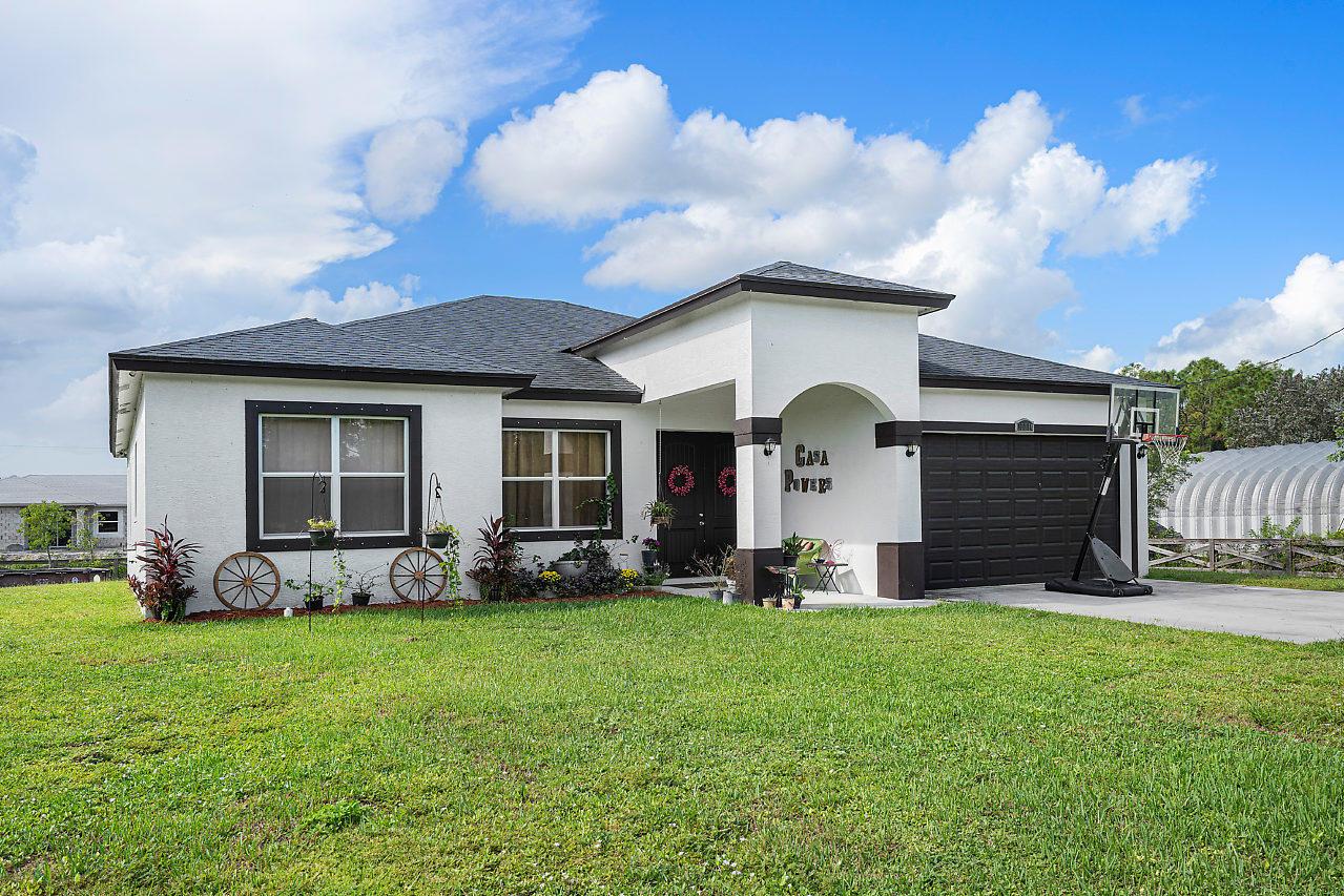 Home for sale in Royal Palm Beach Acreage Loxahatchee Florida