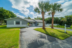 ENTIRELY REMODELED in 2019 !3 bedrooms, 2 bathrooms.  Impact windows,  2016 AC, new kitchen, new bathrooms, new tile throughout and great floor plan.  Huge corner lot with over 12000 sq. ft.  Inground swimming pool and covered entertainment area.  Just bring your furniture and your toothbrush !!!