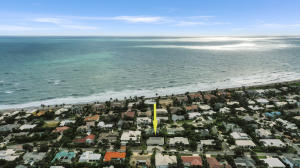Nice High elevation on a wide lot with East exposure. Near the walkway to the beach. Large Circle drive and side yard.