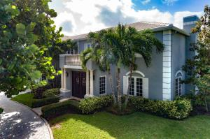 Center Hall Colonial home in prestigious & private Place Au Soleil. Presenting over 5,000 sq ft of renovated space, this classic deep water home articulates pure elegance & caters to the one who entertains & will enjoy all that the South Florida waterfront lifestyle has to offer. Featuring 4 BR 4.5 BA, hardwood & marble flooring throughout, an over sized chefs kitchen & guest suite quarters on the first level.  Formal living with fireplace & dining room, plus a den.  All bedrooms have an ensuite bathroom. Sunny south exposure pool area overlooks the water & dock which can accomodate up to a 50 FT Yacht. Minutes to the open ocean via the Boynton Inlet for the avid fisherman. Discover the privacy, security & beauty of this hidden gemneighborhood with only 93 homes.