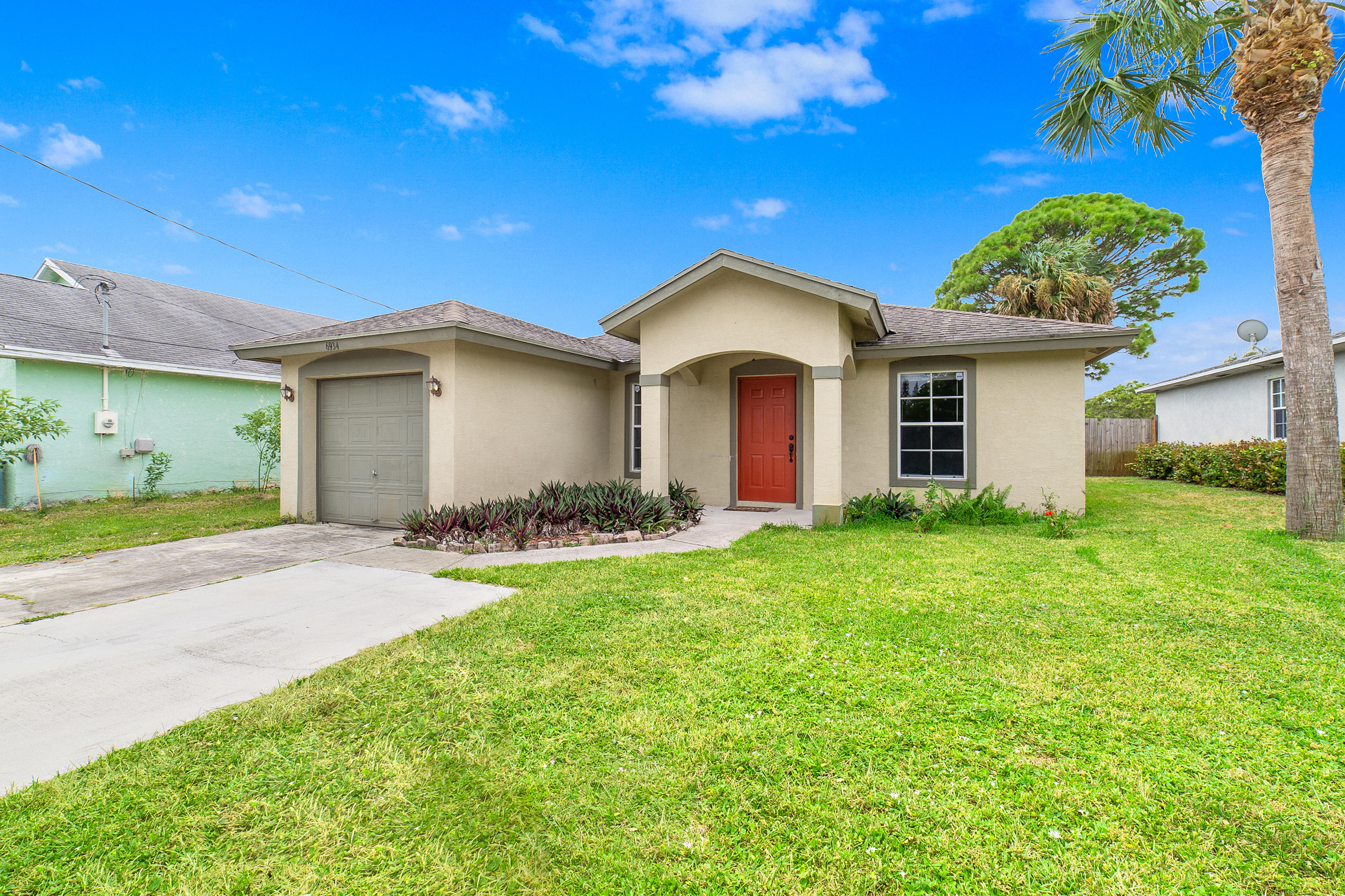 Photo of home for sale at 6934 Mitchell Street, Jupiter FL