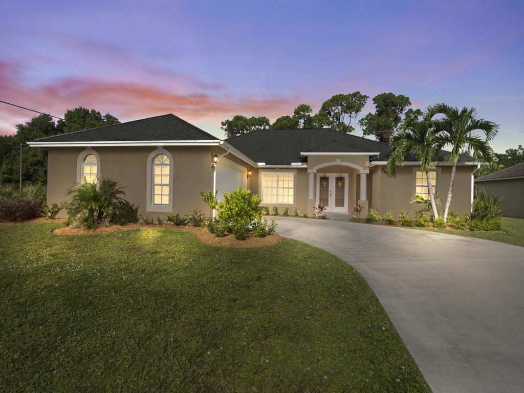 Photo of home for sale at 2685 Acco Road SW, Port Saint Lucie FL