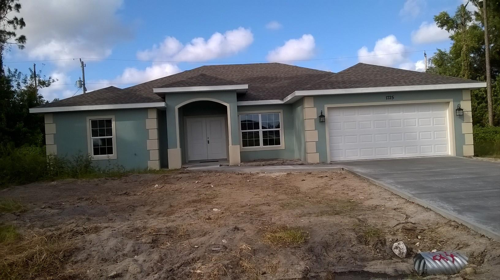 Photo of home for sale at 1725 Finch Lane SW, Port Saint Lucie FL