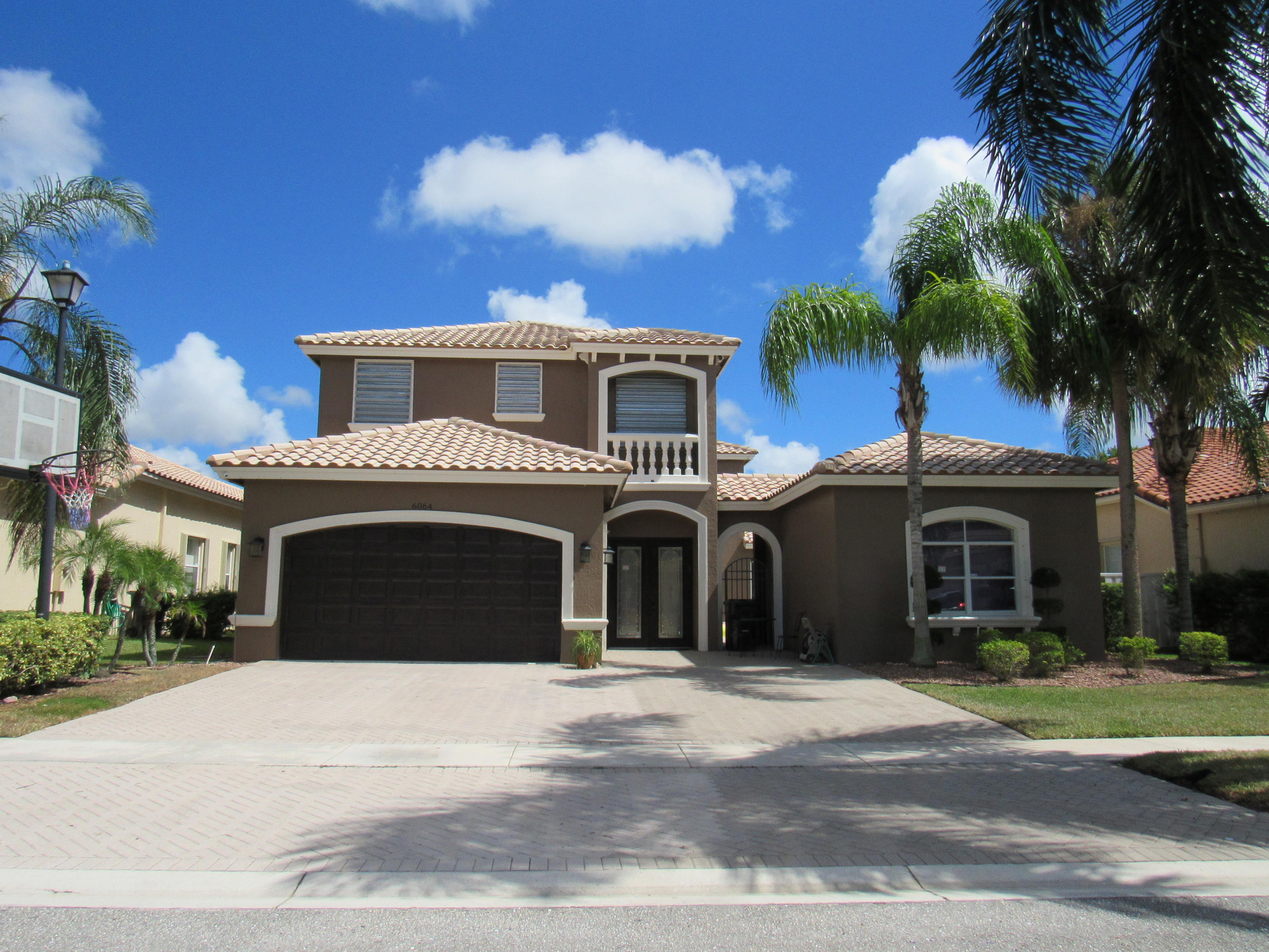 Photo of home for sale at 6064 Bither Way, Lake Worth FL