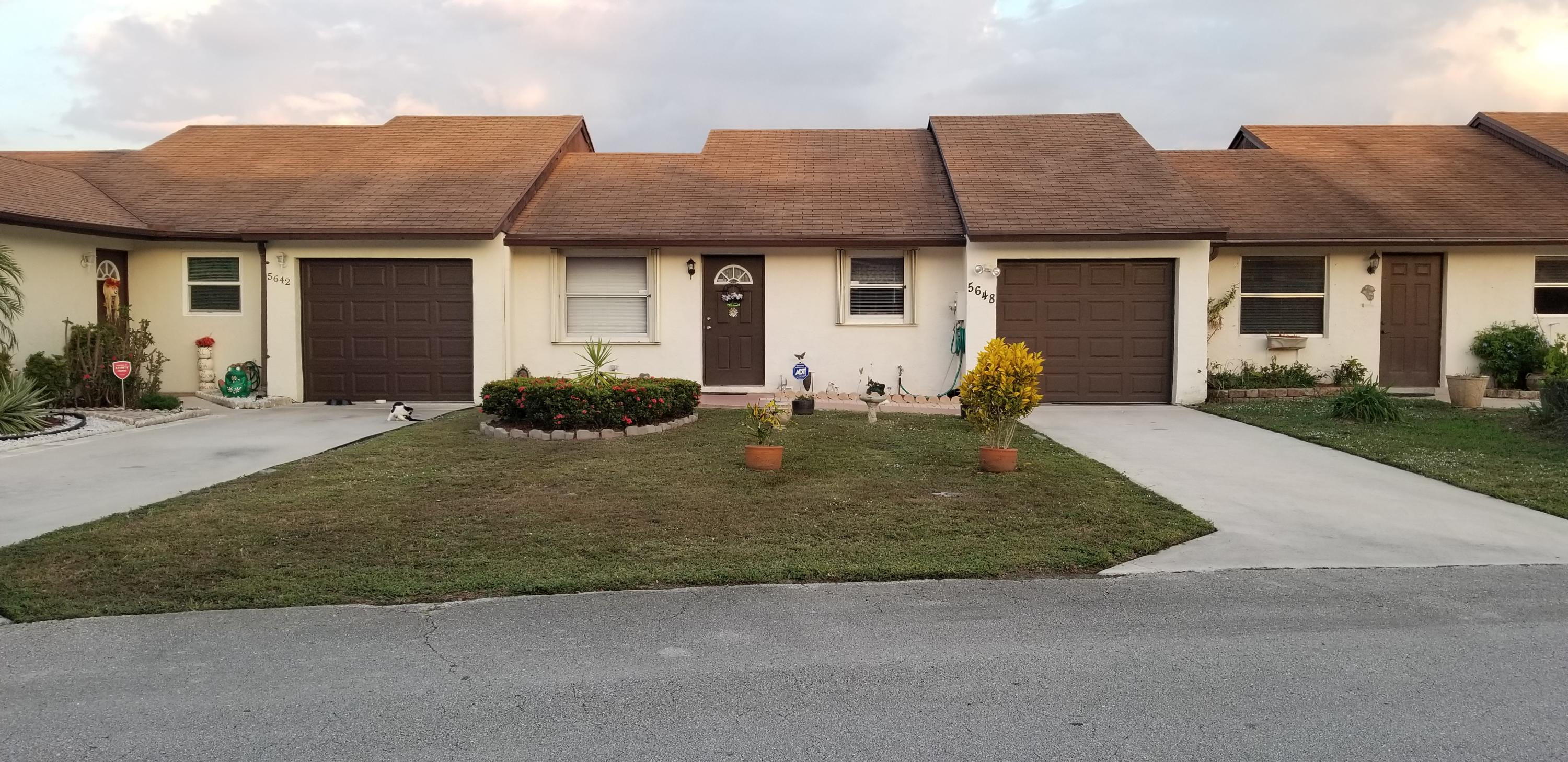 Photo of home for sale at 5648 Waltham Way, Lake Worth FL