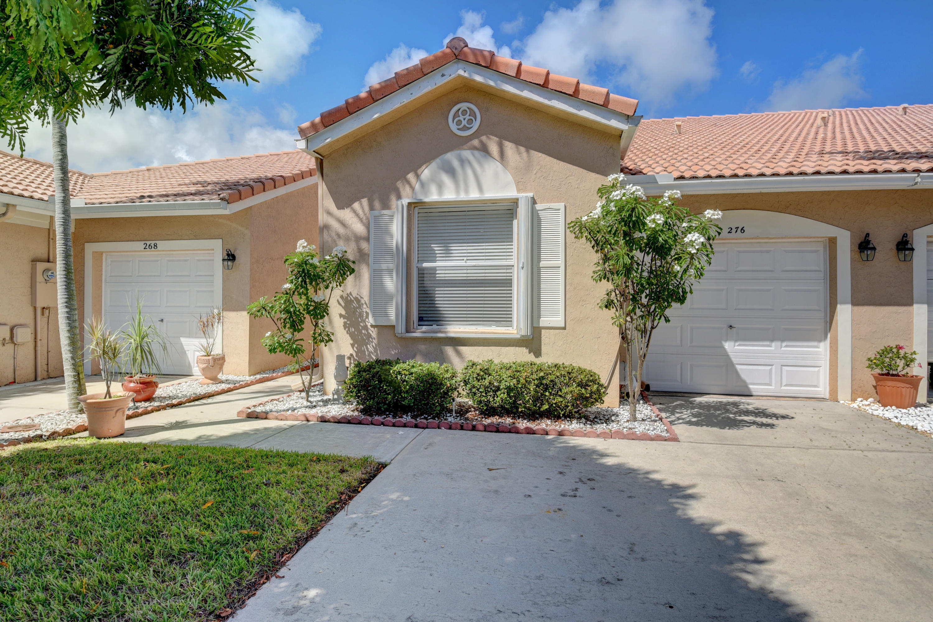 Enjoy this all age villa which is close to downtown Delray and the beach.   It boasts an oversized tiled patio that overlooks the lake.   The villa is tiled throughout, vaulted ceilings, laundry room and has an attached garage. All window have easy to close accordion shutters.  This gated community has low association fees and is able to have FHA financing. The community is beautifully manicured with a pool that is heated in the winter and cooled in the summer.  Click the link for a virtual tour.