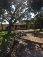 Fenced on 3/4 acre 3 bedroom 1 bath home with attached in law/guest suite or possible rental (legal)with seperate entrance 1 bedroom 1 bath approx.$750 - $800      ZONED MULTI UNITPRIME LOCATION MINUTES TO I-95, BEACHES AND SHOPPING GREAT SCHOOL DISTRICT