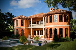 In the exclusive Manalapan-Hypoluxo island community, you will enter a gated Tuscany inspired Intracoastal estate, beautifully appointed in Old World elegance.One of South Floridas most prestigious communities, Hypoluxo Island is tucked away between the Atlantic Ocean and the Intracoastal Waterway in a lush tree-canopied tropical landscape. This stunning waterfront estate provides all the luxuries of a private Mediterranean retreat. The location allows for a totally private environment within its gated area and yet has the advantage of being a short walk to the beach,  The information herein is deemed reliable and subject to errors, omissions or changes without notice.  The information has been derived from architectural plans or county records. Buyer should verify all measurements.