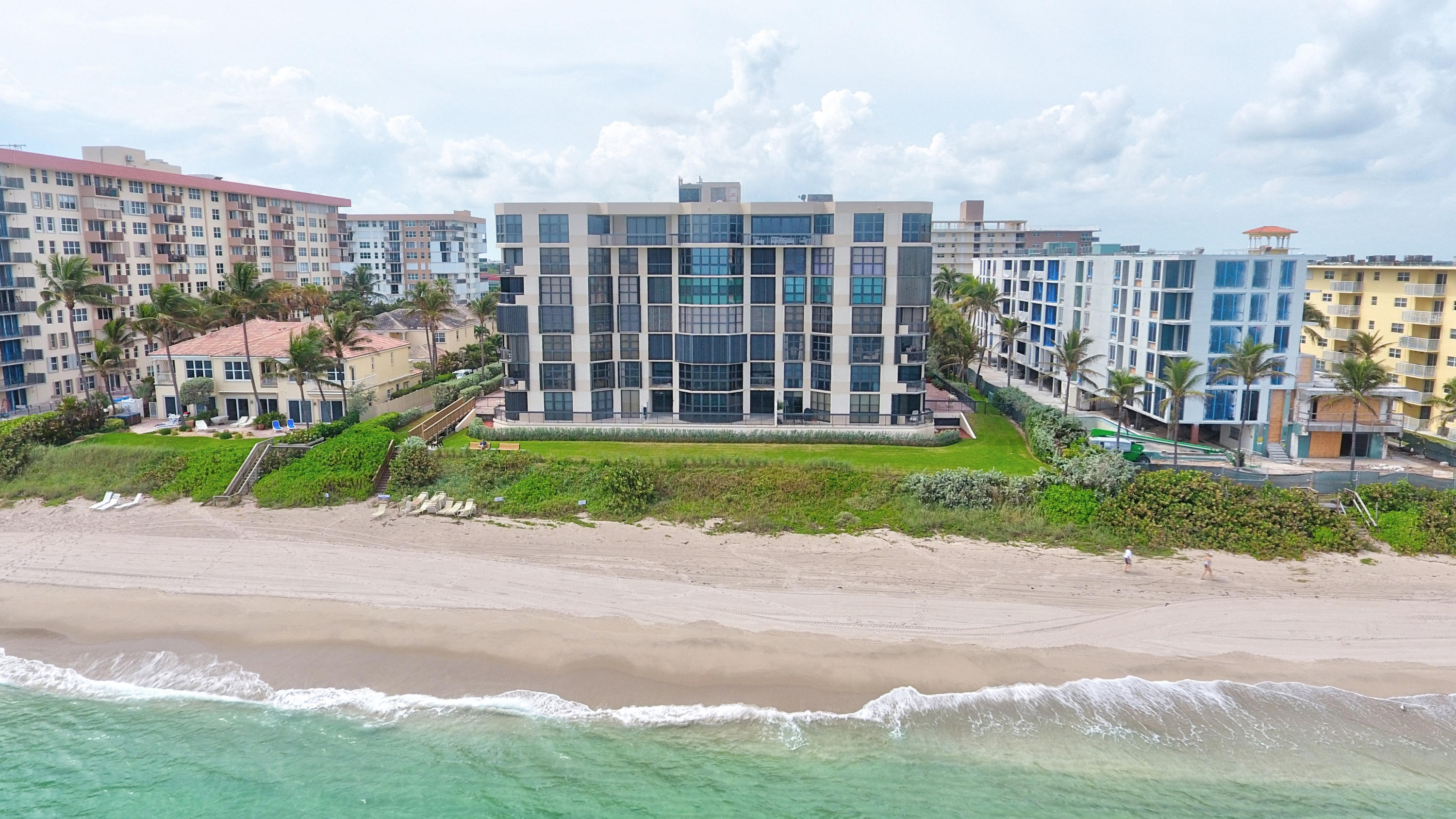 This absolutely stunning and spacious 3 bedrooms condo has a bonus room that can be used as an office/den or a 4th bedroom. Corner unit offers plenty of natural light and fabulous views. Watch the sunrise on the ocean and the sunset on the Intracoastal Waterway from your oversized private covered patios! The property has been completely remodeled with stylish and smart architectural features, including high impact windows, marble floors, custom built-ins, well-appointed closets and a raised eat-in kitchen area, to better enjoy the boat parade. Master bath features dual sinks and a large jetted whirlpool bathtub. Hillsboro Ocean Club is a well-managed boutique building directly on the beach with 24-hour lobby security and gated garage parkin