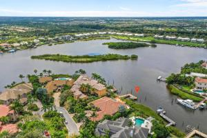 121  Commodore Drive , Jupiter FL 33477 is listed for sale as MLS Listing RX-10574506 photo #1