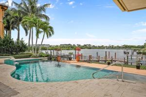 121  Commodore Drive , Jupiter FL 33477 is listed for sale as MLS Listing RX-10574506 photo #35