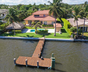 IF YOU ARE A BOATER THIS IS THE PROPERTY FOR YOU. 100 WATERFRONT OPPORTUNITY. 100 Feet of Deep Water. Over 1/2 Acre Waterfront Hypoluxo Island Home. Sparkling intracoastal water views throughout. 3 bedroom, 4 bath. Den easily converts to 4th bedroom. Master Suite on main level. Upper level boasts large open loft space with pool table, 2 bedrooms & bath make for a perfect space while still offering privacy & sophisticated entertaining on the main level. Relax in the lush tropical paradise that is your resort style yard surrounded by water. Pamper yourself in the heated pool/spa & cocktail in your Tiki Hut. Long circular driveway offers privacy, parking & a 3 car garage. Easy access to beach, restaurants, shopping, grocery & highways. Bike or walk to all of it!