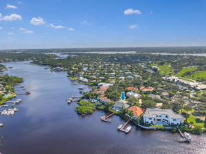 Big RIVER EAST Views! Across Street Tequesta C Club. (SEE DETAIL SHEET) 2 Lifts ~3 Water Depth at Dock. Seawall (2014) w/Stairs to Beach. CBS w/ 2019 Flat Concrete Tile Roof.  Partial IMPACT Glass.  NEW POOL 2015 w/Salt System + Travertine Paver Decking. Zoned HVAC 2017 / 2016. 3 Car Garage w/Added Golf Cart or Work Area w/Double REAR Impact Doors. Paver Drive w/Added Parking Area. GORGEOUS Designer Interior w Wide Plank Hardwood Flooring. Volume Ceilings 24, 14,12 10.  4 Beds PLUS DEN. Spacious Main Level Master w/Sitting Area and Bath Suite w LOTS of Closet Space. LOFT + 3 Beds Upstairs. ORIGINAL OWNER has Construction Floor Plans.