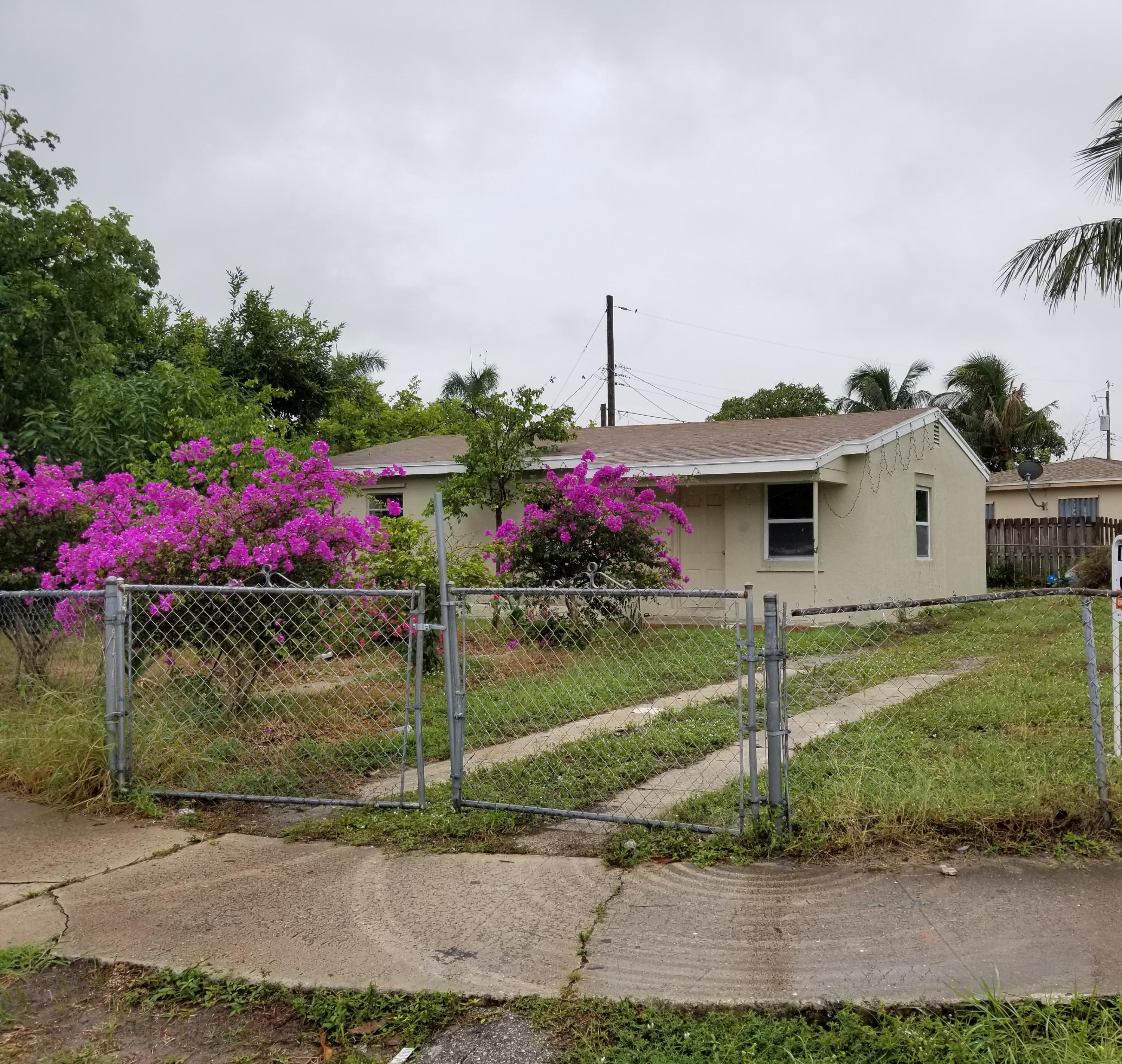 Home for sale in WHISPERING PALMS 5 Lake Worth Florida