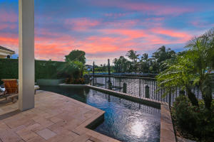 Gorgeous bright deep water waterfront home in private, gated enclave located just off Intracoastal with easy (no fixed bridge) ocean access. Master bedroom on 1st floor with panoramic views of channel & community park. Spacious 5 Bedroom, 5.5 Bath with Private Dock for up to 65 foot boat (10); $500,000+ in upgrades inc: $50,000 Upgraded Pool, Top Shelf Appliances (Wolf, Twin Eagle, Sub Zero, Miele, LG); $50,000+ landscaping upgrade; Flooring (Creme De Marfil Select), Upgraded Wood Floors & top quality carpeting); Marble Pavers; Upgraded Garage & Expanded Kitchen; Bose Invisible Home Theater in family room & Bose invisible audio systems in great room, master bedroom & outdoor Lanai; Video Surveillance; Icynene Insulation; Tongue & Groove Expanded Lanai; Coffered Ceilings; Custom Mirrors