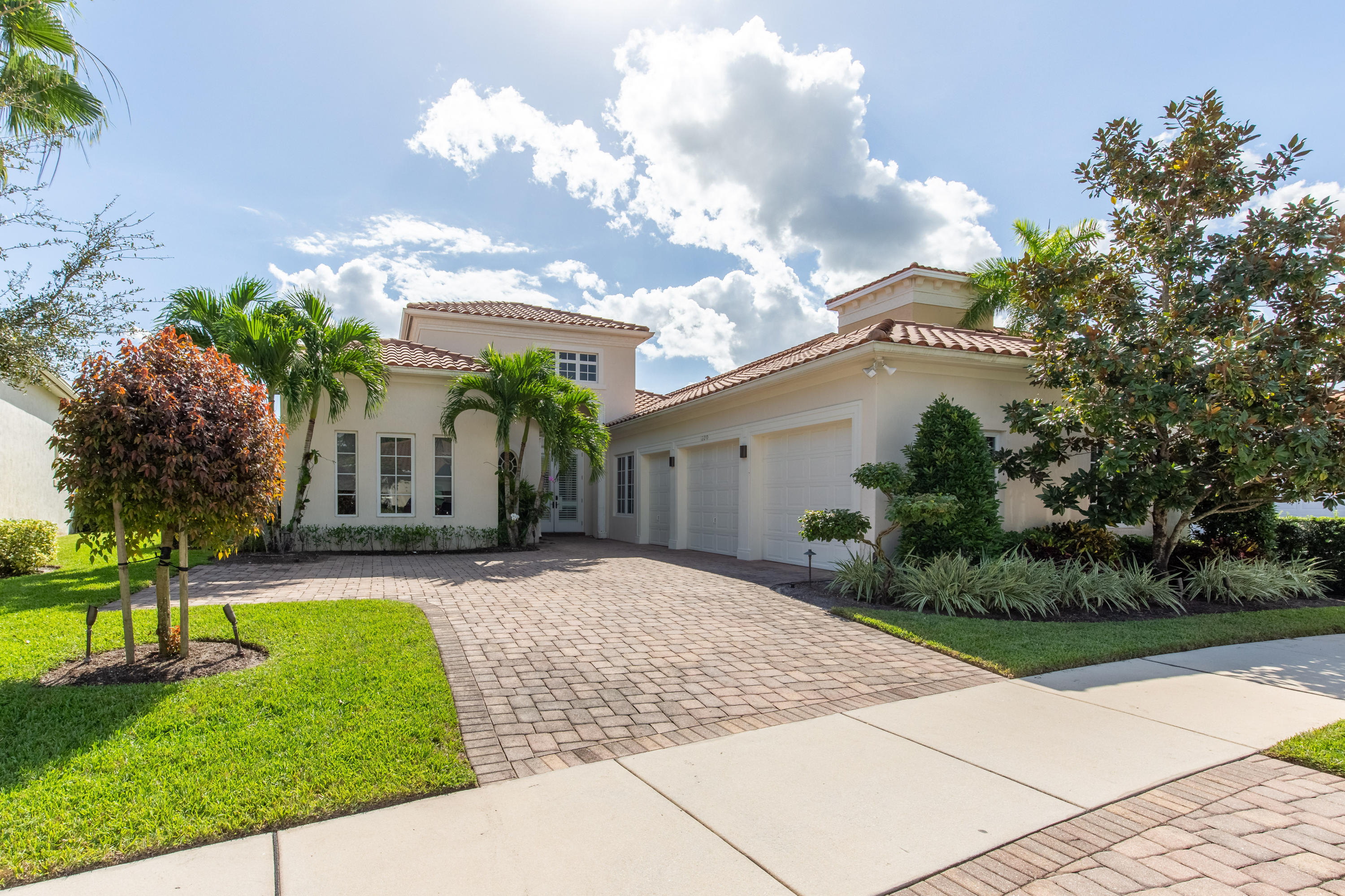 Welcome to this waterfront pool home located in Hunter's Chase of the Palm Beach Polo Club. The stun