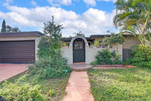 This Ocean Walk, Lantana home provides a large, fenced in corner lot with plenty of privacy. A lush, tropical paradise surrounds a huge new pool, patio, and tiki bar. Walk out the French doors and escape into your tranquil, environmentally friendly butterfly garden. Walk to the beach (1 mi.), Nature Preserve or the infamous Old Key Lime House (0.5 mi.). The home offers so many unique spaces, like the cozy courtyard as you walk in through the handmade wooden doorway. The Spanish Saltillo tiles throughout provide a warm welcome as you enter. Three large bedrooms and a den, which can be used as a guest room/4th br offer plenty of space for everyone. A quick fifteen-minute drive gets you to Delray Beach, West Palm or Palm Beach International Airport. Come see this home before its gone!