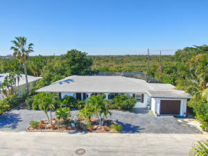 Walk to beach! CBS 3/3 with screened in pool and spa. 1 car garage. No HOA. AC 2016, Oversized wide lot. This spacious home has an open split floor plan, some impact windows, 18 tile, newer SS appliances.  This home has loads of potential.  2nd floor options could create Ocean Views