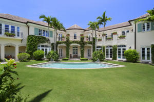Gracious French Normandy home on over half an acre in the Estate Section of Palm Beach. Luxurious privacy landscape, designed by Mario Nieviera, surrounds the property and the many hidden seating areas and covered loggias by the pool. French doors can be found in most rooms, opening onto the lush grounds or a sun deck on the second floor. High ceilings and designer finishes greet you in the entry foyer and lead to a dramatic sweeping staircase, open on the second floor with some views of the Intracoastal. The home has impact windows & doors, whole house gas generator and 3-car a/c garage accessed from the rear laneway. Private Beach access via gated easement.