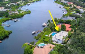 Spectacular riverfront home located on the North Fork of the Loxahatchee River on 1/2 acre + lot. This stunning pool home features 5 bedrooms, oversized loft, 4.1 baths & 2 car garage with over 4800 sq ft. SOLID built 2 story CBS home featuring ALL IMPACT DOORS & WINDOWS, hurricane rated newer roof, and foam/icynene insulation for extra stability & high efficiency. Impeccably maintained by the owner, the newly renovated upgrades include: custom island kitchen with custom white cabinetry with soft close, mitered 6cm quartz counter tops, custom tile back splash, farmers sink and stainless steel appliances; newly stained wood flooring throughout, new dock w/ electric & water, new 12K lb boat lift, 2 new 5-Ton AC units, new travertine marble patios, house generator ....