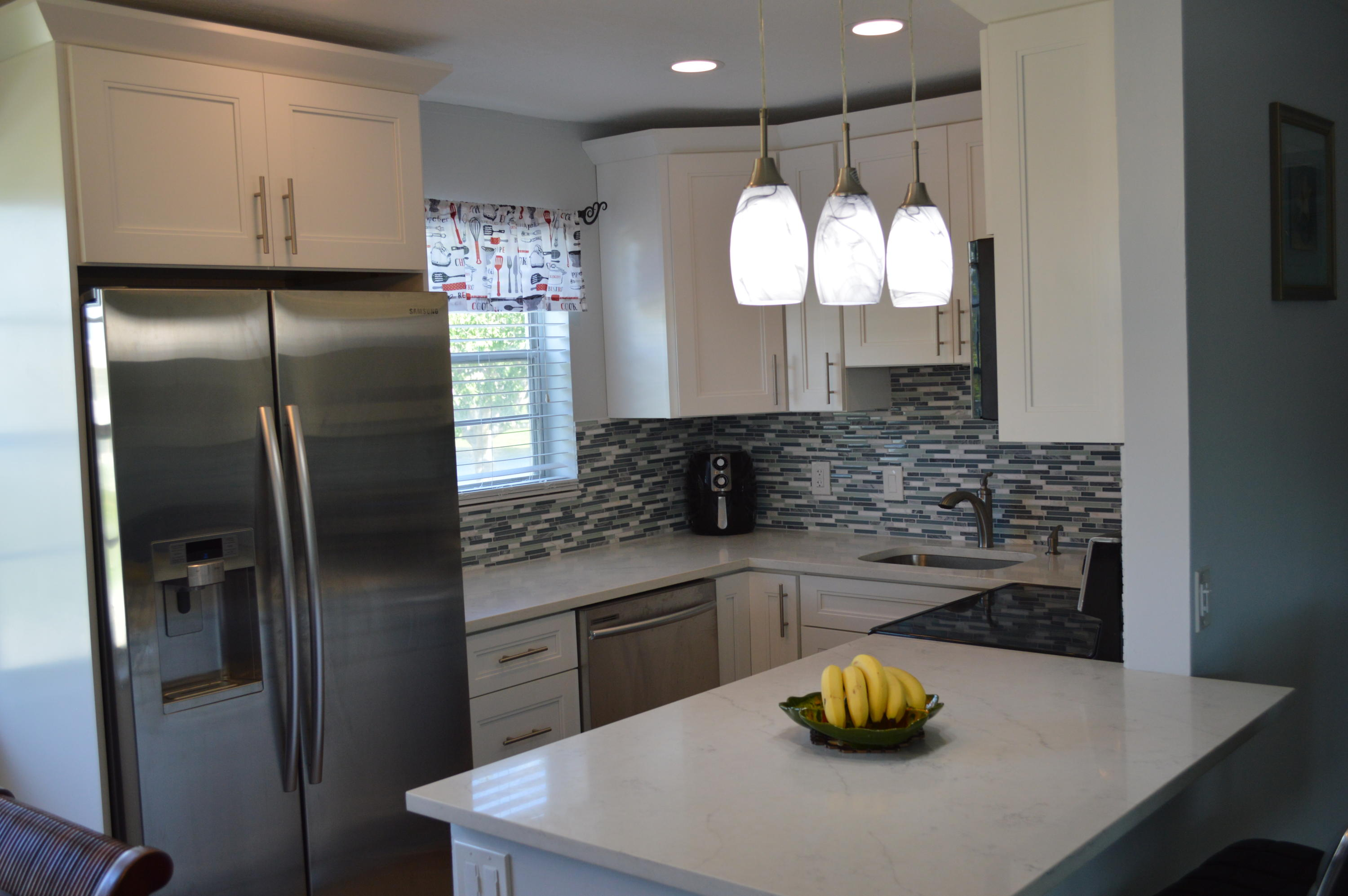 Beautifully updated 2 Bedroom 1 and 1/2 baths, much sought after, corner unit in Century Village - Kitchen recently updated, new appliances, new backsplash, new cabinets and bathrooms have been updated as well as the flooring.  This is priced to sell, it will not last.