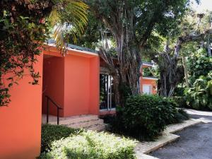 First time on the market in 35 years.   Renovate this 50s modern home or build new on the very private approx. 19,264 sq. ft. lot in the exclusive 11-home lake-block enclave of via Vizcaya, in the heart of the Estate Section.Design options may offer ocean views from the second floor and access choices from Vita Sirena.Current Survey & Elevation Certificate available.