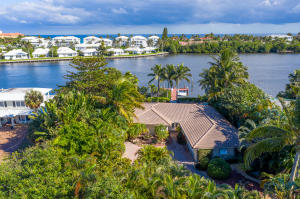 Tucked away on a most private parcel with East-facing Intracoastal water views on Hypoluxo Island in Lantana. This perfectly private setting includes a fenced yard with heated pool/spa and deep-water dockage with easy Ocean acess.  This 2,650 total SF home has a gated entry and circular decor drive that accommodates 6 cars in addition to an attached 2-car garage.  3 Bedroom, 2.5 Bath residence has wood flooring throughout and an open layout.  Living areas and Master Suite access pool/patio areas with beautiful water views.  Spacious 25 x 16 Family Room includes a Breakfast Nook. A simply perfect seasonal or year-round residence.  Waterfront, Island living at its Best!  Walking distance to Ocean Beach, shopping, dining and the Eau Palm Beach Hotel and Spa.
