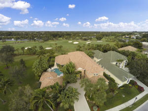 EXCEPTIONAL OPPORTUNITY to own a beautiful 5 bedroom 6.5 bath plus den custom home including a guesthouse and four car garage on a large PRIVATE  corner lot in the prestigious ST. GEORGE  neighborhood in BallenIsles. Enjoy panoramic golf course and spectacular sunset views in this home with 22 foot ceilings. Numerous 2019 updates: NEW ROOF, 4  AC units, 2 water heaters, pool pump, carpeting and wood floors. Other features include custom outfitted office with plantation shutters, massive first floor master bedroom suite with wood flooring and his and her updated master baths. Impact glass strategically placed throughout the home including safe room guesthouse and whole house generator. Home may be purchased with rare Sports Membership or can be upgraded to Full golf, if desired.