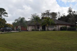 Large 4000 square foot estate in beautiful Loxahatchee. This tastefully designed home offers four large bedrooms, two full baths, a strategically placed half-bath, generously sized kitchen with island, formal dining room, large 500 square foot patio, and so much more.Located just off Seminole Pratt Whitney Road, and halfway between Okeechobee and Southern Blvd, this home is within relative close proximity to major roadways and shopping and entertainment centers. Property is in need of updating/TLC and is being sold AS IS with the right to inspect. CASH only.