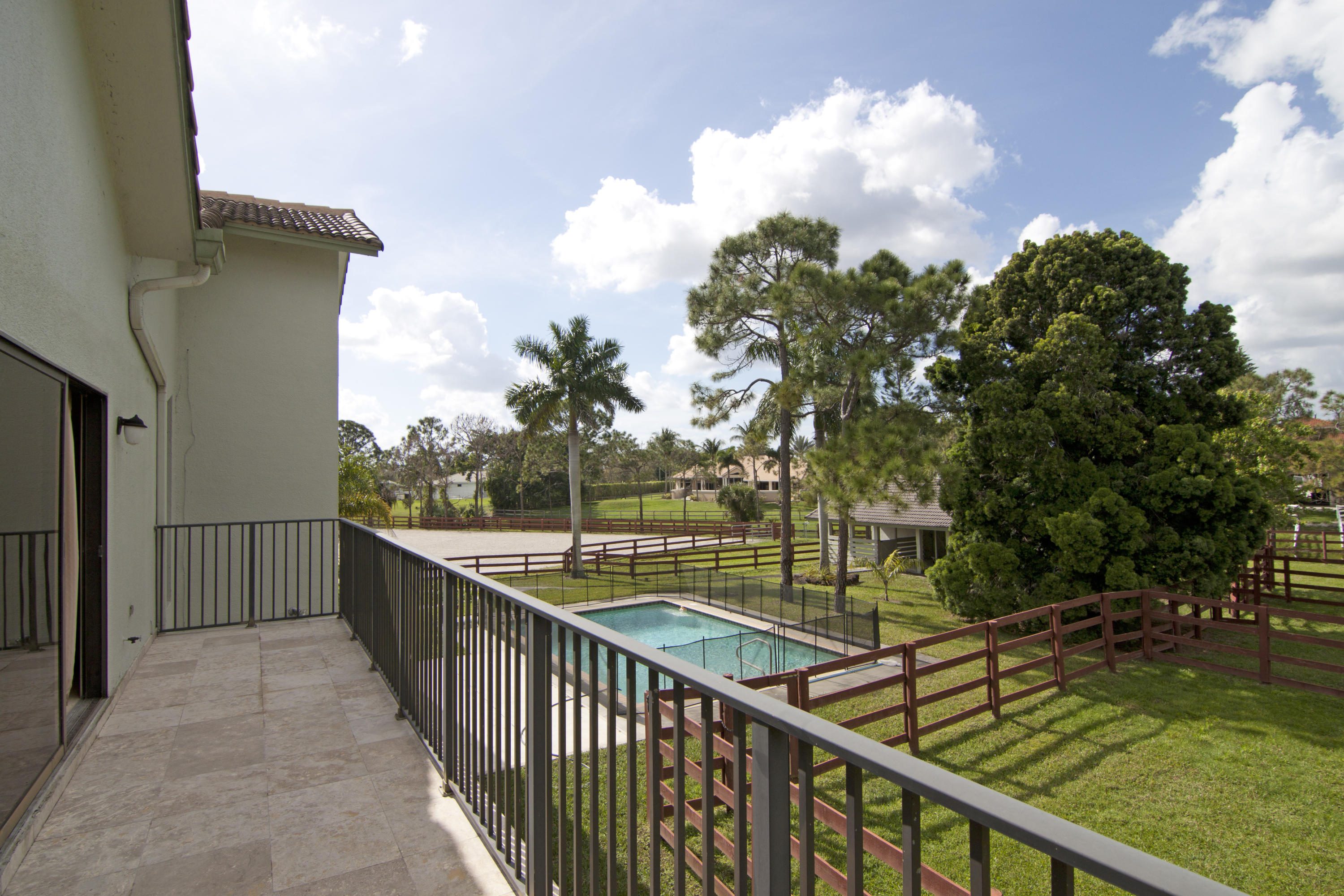 Balcony view of paddocks , pool and ring