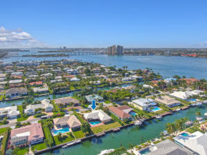 Great opportunity to renovate or tear down and start new. This lot boasts a depth of 130 with 90 of water frontage on a deep water canal with turning basin.   Ocean access, no fixed bridges and only minutes to the Palm Beach Inlet make this a highly sought after location.  Singer Islands beautiful beach is just a short walk away with neighborhood deeded beach access.