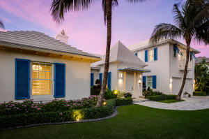Built in 2015, this 4,808 square foot Bermuda-style home offers beautiful modern finishes throughout. The spacious living room is adorned with white Venetian plaster walls, a vaulted ceiling, and retractable doors that open to the large covered loggia. The kitchen is equipped with Miele appliances, a Sub Zero refrigerator and freezer, a large center island, a gas range, a walk-in pantry, and has a dining/family room area with doors to the outdoor loggia. A library, powder room, guest suite, and laundry room complete the first floor. Upstairs is the master suite with an en-suite bath and walk-in closet, built-in shelving, private outdoor terrace with retractable awning, as well as an additional luxurious walk-in closet with bath that could be turned back into the third bedroom. Other