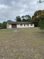 BEAUTIFUL, OVERSIZED, CORNER LOT IN A VERY ACCESSIBLE LOCATION IN LOXAHATCHEE! 1.75 ACRES, FULLY-FENCED! RIGHT AT THE CORNER OF 162ND AND MAYFAIR. NOT A THROUGH-STREET, VERY PRIVATE! OVERSIZED MASTER WITH BATHROOM SUITE! GARAGE IS 532 SQ FT! PROPERTY SOLD AS-IS. CASH ONLY. NO WATER OR ELECTRIC. ALL SIZES APPROXIMATE.