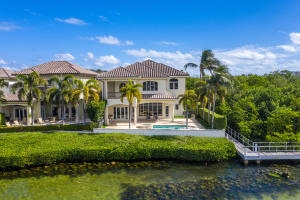 Gorgeous Estate on the Intracoastal located in Ocean Cove, a gated enclave of only 22 Estates offering private ocean access . Property features 10.5 acres of nature preserve to the south side of the property, So NO property can ever be built next to this house.  Grand entrance with floor to ceiling Hurricane proof windows allowing for expansive  views of the Intracoastal and mesmerizing sunset.   Oversized master bedroom with an additional Workout room, 2 large closets and a  Huge Master Bathroom.  Other notable features include a full home generator , elevator, and private dock to accommodate up to 50ft yarcht .