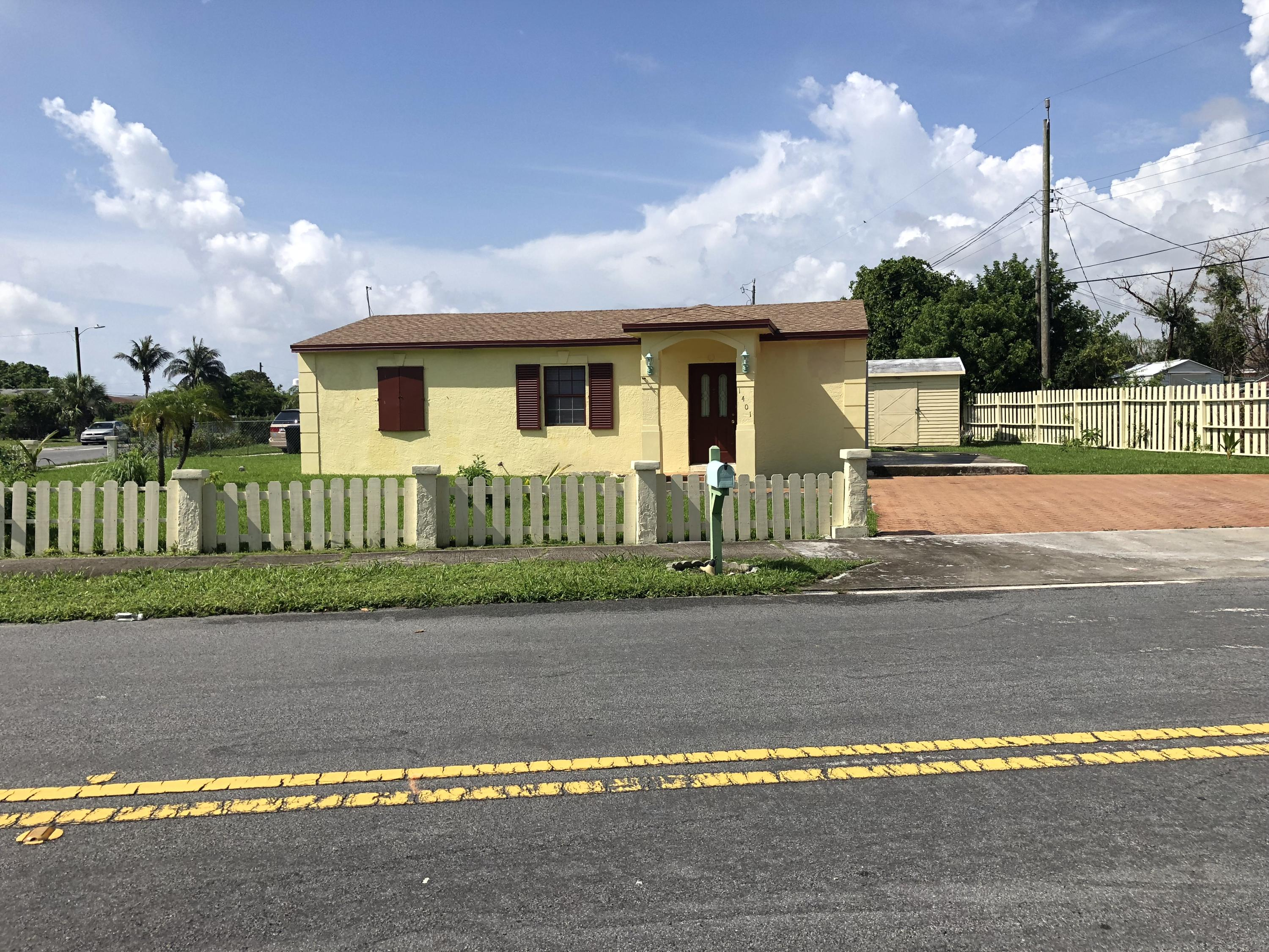 Home for sale in WHISPERING PALMS 4 Lake Worth Beach Florida