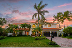 Rare opportunity to purchase 4,000+ AC sf CBS home just steps to the secluded beaches of Jupiter Inlet Colony. This 4 bedroom + den, 3.1 bath home with 2 car garage features great open floor plan, volume ceilings, beautiful spiral wooden stairway. All 4 bedrooms, including both downstairs & upstairs master suites, are over-sized & feature large walk-in closets, spacious & elegant bathrooms. (Floor plan & survey are attached to listing). The expansive open floor plan features marble flooring in living areas with 3 double French doors that open up to the picturesque pool deck. Just steps from the elegant formal living room is the spacious eat-in chefs kitchen with over-sized island, newer stainless steel appliances with gas cook top available, attractive granite counters with tumbled marble