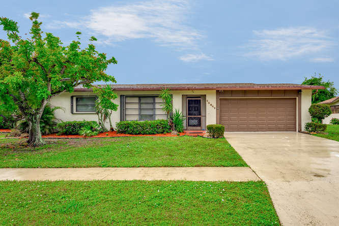 Home for sale in Coco Wood Lakes Delray Beach Florida