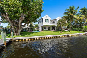 This is the one! Incredible opportunity to own a custom Bermuda style (2016) 4 bed+office/den, 3 bath riverfront home. Located in Cove Point, a quaint Old Florida style community on desirable south facing, wide water lot w/ 139+ of waterfront. The home of an interior designer, no detail was overlooked. Thoughtfully designed open floor plan, high ceilings, custom millwork/built ins, marble finishes, gas fireplace, expansive master w/ office, bath & his/her closets. Enjoy all day sun & sunsets from your large backyard, heated pool & covered patio. Paddle board the river & mangroves, take your boat to the sandbars, fish from your private dock (w/ lift). Golf cart ride to Tequesta & Turtle Creek golf clubs. Close to all Tequesta/Jupiter offers but in Martin County w/ lower property taxes.