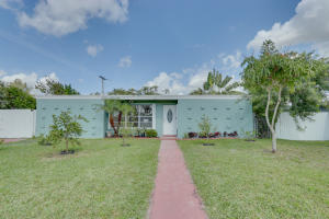 Newly Remodeled 3 bedroom 2 bath with NO HOA and A rated Schools!  Large space on side of the house for a 30ft boat or RV.  Optional 4th bedroom/office!  Complete Hurricane Accordion Shutters were just installed on every window and door. This home has a brand new Heat/AC system inside and out and newly refinished roof.  Exterior and Interior just freshly painted with two coats of paint! Fully remodeled kitchen with Granite and stainless steel appliances including French door refrigerator and double oven.  Oversized pool, large paver patio and 6 foot privacy fence complement this homes large private treed in backyard. This home is in the heart of Royal Palm Village in one of the most sought after neighborhoods. Close to the beach, Commons Park, Turnpike, 95, shopping and restaurants.
