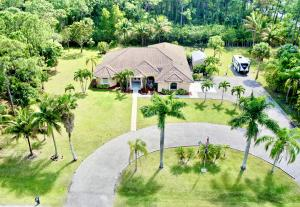Come see this custom built home with 4 bedrooms 3 baths plus a den, sitting on 1.80 Acres!!! This tropical paradise comes landscaped with coconut, banana, orange and many mango trees!!! 15,000 kw generator that will supply 2/3 of the entire house! Accordion shutters, S-Tile Bitumen roofing for added longevity. Newer 12x24 shed with electricity!! Relax on your new screened patio overlooking the large backyard with room for a pool!!  Movie night will be awesome in the custom movie theatre room with a bar and Denon sound system!!! Osmosis system in the kitchen and newer water softener tank! Bring the dogs, the boat and the camper as this home is already equipped with 30 amp hook up! There are so many features that this home has to offer, so make an appointment to come and see for yourself!