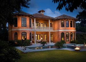 This gracious Hypoluxo Island estate, with 100+/- feet on the Intracoastal Waterway and a private beach and deep-water dock, features romantic Tuscan-inspired architecture and grand interiors. In the west-facing back yard, set within serene tropical gardens, a lanai and BBQ summer kitchen, along with an oversized pool and spa, overlook wide-water views and scenic sunsets. The information herein is deemed reliable and subject to errors, omissions or changes without notice.  The information has been derived from architectural plans or county records. Buyer should verify all measurements.