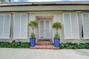 MOST CHARMING IN TOWN REGENCY VILLA. FRENCH MILLED CUSTOM WINDOWS AND DOORS THIS HOME IS HIDDEN BEHIND TALL PRIVACY HEDGES WITH A LUSH PRIVATE GARDEN FOR ENTERTAINING. ONE BLOCK TO THE OCEAN/ BIKE TRAIL.