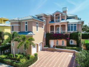 A truly unique beachfront offering in the seaside, gated community of Jupiter Key! Enjoy the sparkling Atlantic Ocean views and continuous breeze from multiple balconies and vantage points. This completely customized home features a private backyard oasis that is perfect for outdoor entertaining. A large pool and spa deliver a resort-style feel, while the extended loggia and outdoor fireplace offer plenty of areas for lounging or dining. A rare-find, this home has both a main house and a guest house allowing for optimal privacy and convenience. The main residence features an open gourmet kitchen, formal dining room, large master suite, guest suite and a private elevator. The grand family room has a built in bar,  an office and multiple balconies to enjoy the views.