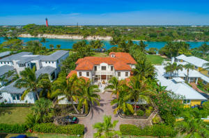 Spectacular direct Intracoastal home on the turquoise blue water in Jupiter Inlet Colony, the premier location of Jupiter Island!  The expansive 6,899 AC sf estate  was built in 2007 & features great views from almost every room, excellent floor plan, impact windows & doors, solid concrete & steel structure on an over-sized .7 acre-Intracoastal lot overlooking the historic Jupiter Lighthouse!   The spacious double-island kitchen features beautiful wood cabinetry, granite counters, commercial grade gas cook top & plenty of space for bar stools & breakfast nook.   Other features include wood & marble floors throughout, elevator, spacious outdoor living area with heated pool & spa, 4 car garage, spacious grand master suite with large balcony overlooking the Intracoastal, dock with boat lift