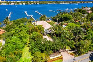 A BOATERS DREAM LOCATION! LUXURIOUS INTRACOASTAL VIEWS! THIS FABULOUS ONE OF A KIND  CUSTOM 2 STORY WATERFRONT ESTATE COMPOUND WITH A PRIVATE 165 DOCK WITH 2 LIFTS LOCATED ON THE MAIN INTRACOSTAL WATERWAYS. IF YOU LIKE SEEING BOATS PASS BY THEN THIS CUSTOM HOME IS MEANT FOR YOU. PRIVATE BEACHSIDE BACKYARD. NO FIXED BRIDGES, MINUTES FROM THE OCEAN.  THIS HOME FEATURES HURRICANE IMPACT WINDOWS AND DOORS, WATER VIEWS FROM EVERY ROOM, WOOD/IRON STAIRCASE, 15X17 FOYER, DOUBLE DOOR ENTRY, PAVERS, GRANITE COUNTERS,  MARBLE FLOORS, LUXURIOUS MASTER WITH TWO WALK-IN CLOSETS, PRIVATE WATERFRONT BALCONY, 20 TRAY CEILING, 13X21 BATH, SEPARATE SHOWER AND WATER CLOSET WITH BIDET, HUGE COURTYARD & TERRACE  HEATED POOL & SPA.