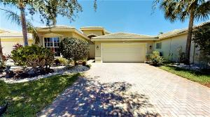 This one is for you with upgrades throughout. Serene lake view, Kitchen with upgraded wood cabinets, granite counter tops and splash back, pull outs, lazy Susan, and stainless steel appliances. Pantry wood floors on the diagonal in living areas.  Master bedroom has 2 walk in outfitted closets, with master bathroom with dual sinks with granite counter tops, Kohler undermount sink and upgraded faucets, pull out shelves, frameless shower enclosure and separate whirlpool tub. Guest bedrooms closet with built in shelving. guest bathroom with granite counter tops, Kohler undermount sink and upgraded faucet, with step in shower. Built ins in den/3rd bedroom. High Hats and ceiling fans throughout. Extended screen enclosed lanai, extended garage and accordion shutters!  Must See! Great Price!