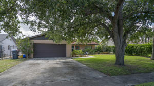 Come see this - Solid 1983 cbs home with a split 3 bedroom 2 bath & 2 car garage under 300k.  This home has everything you need and is in turnkey condition.  The kitchen features granite and white shaker cabinets & two lazy susans.  Kitchen was upgraded within the last 5 years.  The flooring is a laminate wood that looks beautiful and carries through most of the home.  The master bedroom is large and the master bathroom was updated with in the last 3 years.  The shower has those nice white subway tiles and a new vanity with dual sinks.  The list goes on!  The roof was replaced in 2005 and is great shape.  The air conditioner is an upgraded Ruud system that was replaced within the last year.  We love cool clean air.  😎