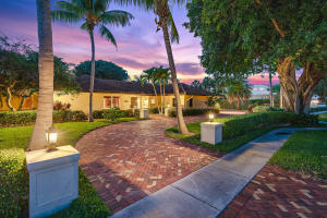 Rare opportunity to live in one of the areas most prestigious, Idyllic settings...Captains Key. Only 26 homes in this gated + secure enclave just steps from the Ocean. This one of a kind classic residence sits on 1/2 acre surrounded by towering trees, bricked walkways + 192 of 4K psi concrete Seawall.  Full renovation in 2006 was thoughtfully designed to update + expand living areas, blending elegant style with modern comforts. Impeccable 4 BR + 2 Dens + executive Office home offers 4200+ SF of living space protected by Anderson Impact Windows + Full House Generator.  Design elements include hand crafted reinforced mahogany door entry, highest end solid interior doors, custom millwork + cabinetry throughout.  Main living areas are generous in size + great for entertaining.  Formal living